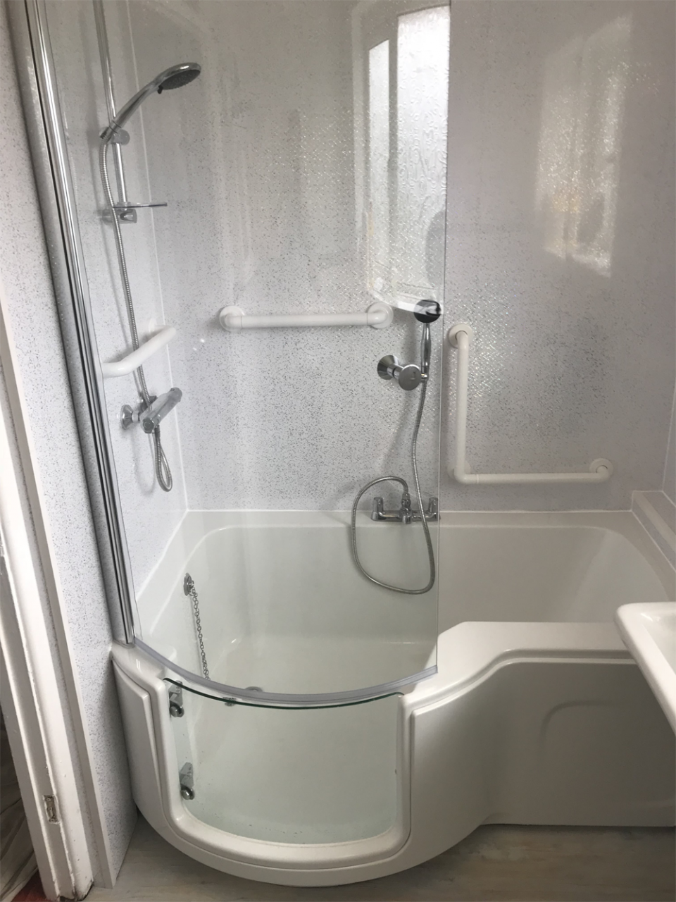 Stylish and practical walk in bath with glass door installed in Tamworth bathroom
