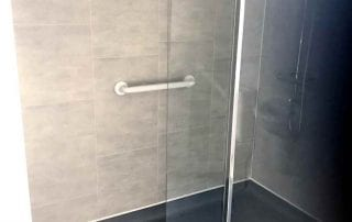 Garage converted to provide an Accessible Wet Room with a level floor walk in shower