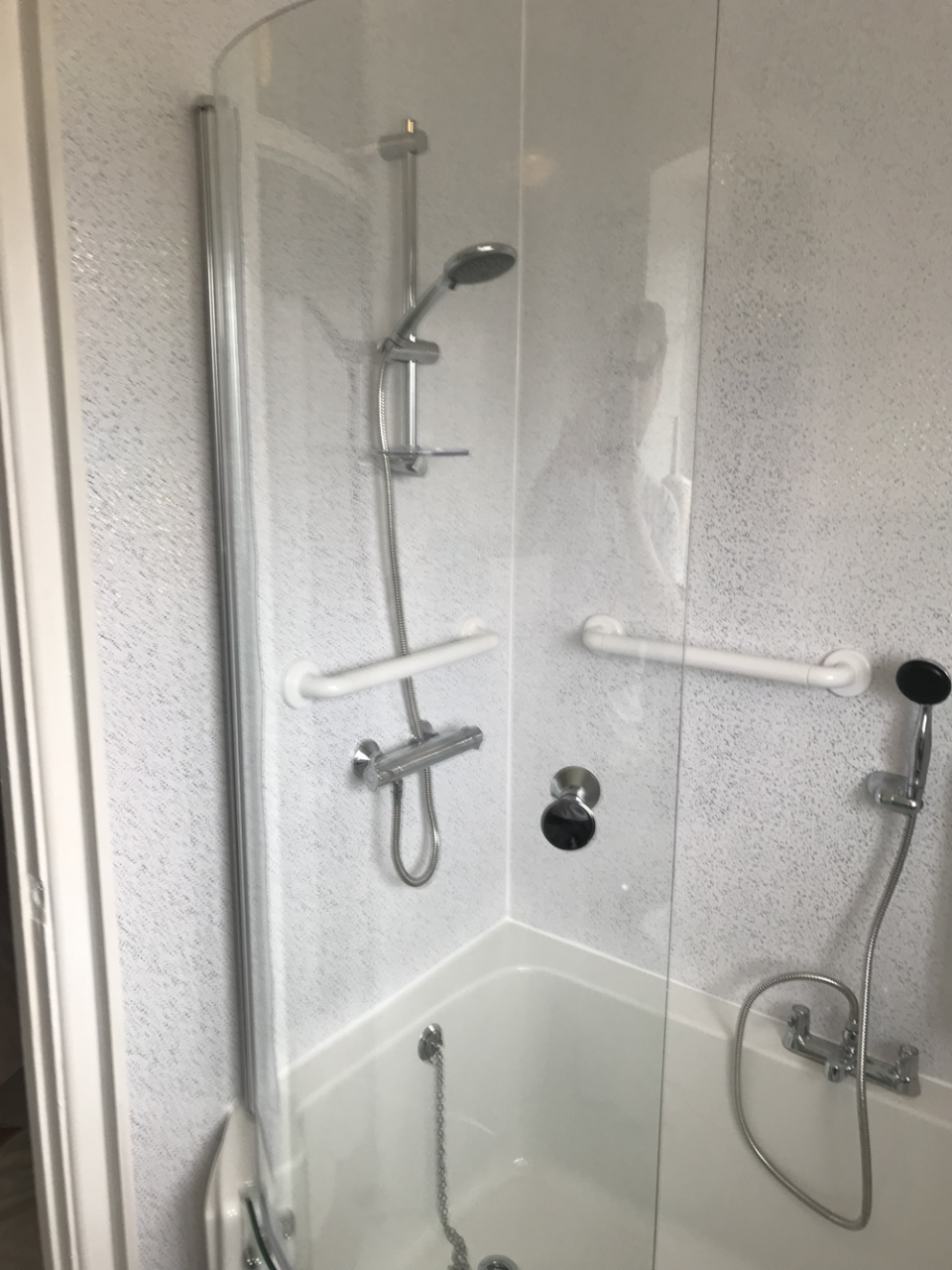 Luxury walk in bath with shower and glass shower door fitted
