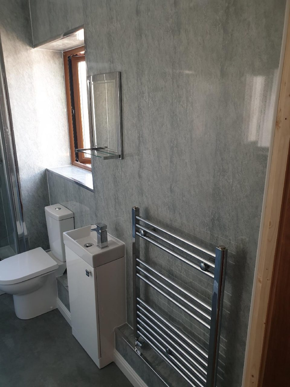 New Bathroom Mrs Wootton in Birmingham Ensuite with chrome radiator