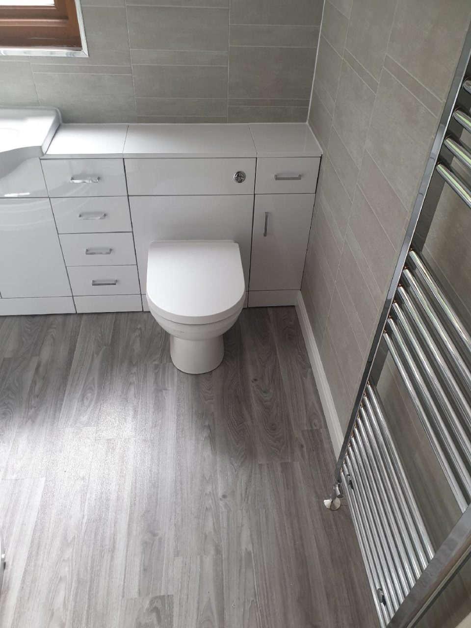 New Bathroom Mrs Wootton in Birmingham New Fitted Toilet and Chrome radiator