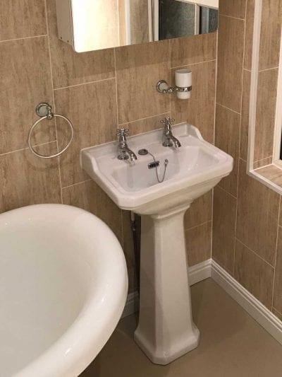 Pedestal sink unit installed in bathroom Designed for All Family