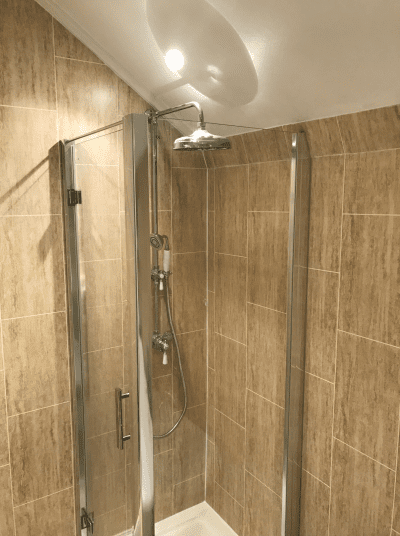 Corner shower enclosure fitted in bathroom designed for the whole family